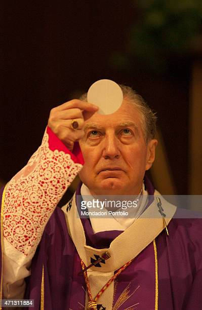 The Archbishop of Milan Cardinal Carlo Maria Martini in the purple mozzetta of the Advent time raises the Eucharist in the church of St John the...
