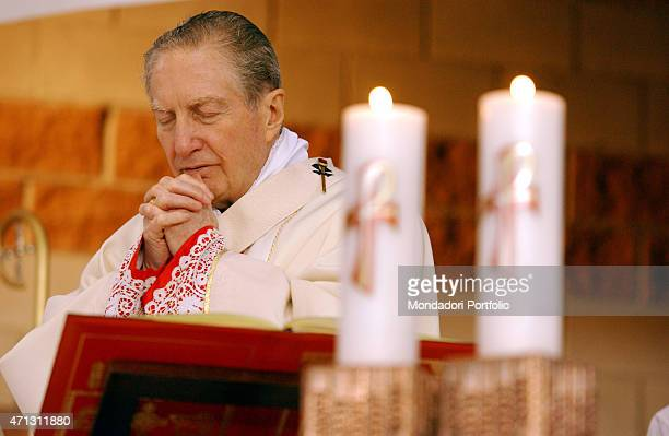 The Archbishop of Milan Cardinal Carlo Maria Martini prays intensely celebrating Mass in the church of St John the Baptist Garbagnate Milanese Italy...