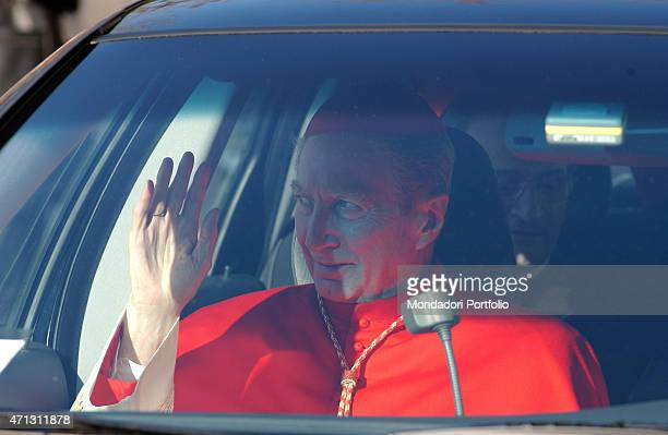 The Archbishop of Milan Carlo Maria Martini in the red mozzetta as a cardinal is portrayed into a car waves to the faithful after the celebration of...