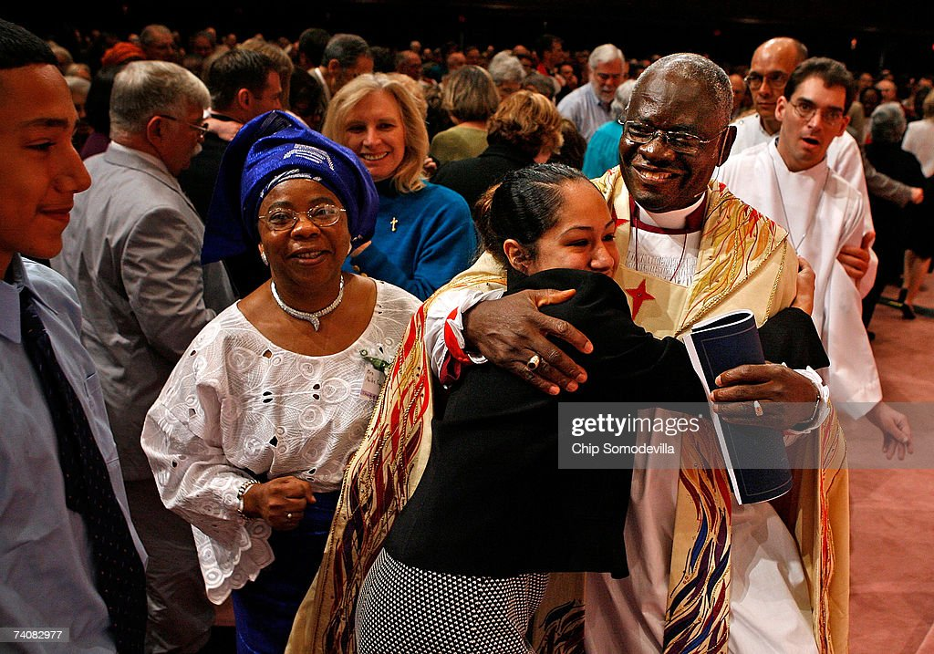The Archbishop of the Anglican Church of Nigeria Peter Jasper Akinola is embraced by congregants during the investiture of the Right Rev Martyn Minns...