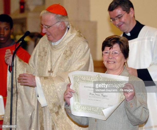 The Archbishop of Westminster Cardinal Cormac MurphyO'Connor presenting Annie Maguire with the Bene Merenti medal