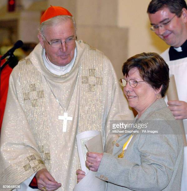 The Archbishop of Westminster Cardinal Cormac MurphyO'Connor presents Annie Maguire with the Bene Merenti medal