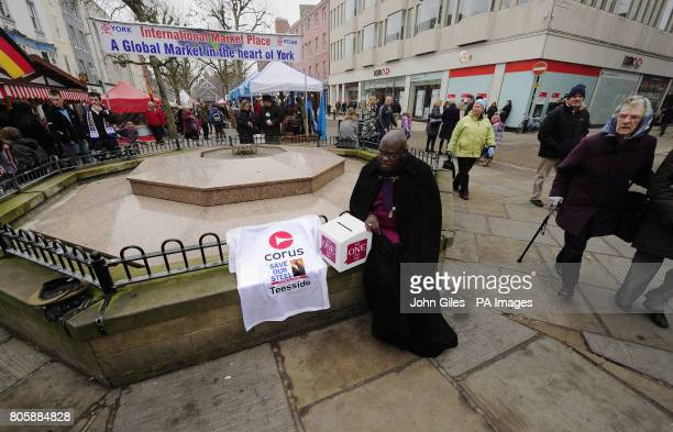 The Archbishop of York Dr John Sentamu next to a Tshirt displaying the message Save Our Steel as he collects prayers in York Market as part of the...