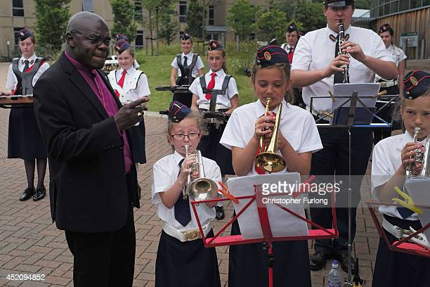 The Archbishop of York John Sentamu listens to a band entertaining delegates arriving for the afternoon session of the annual Church of England...