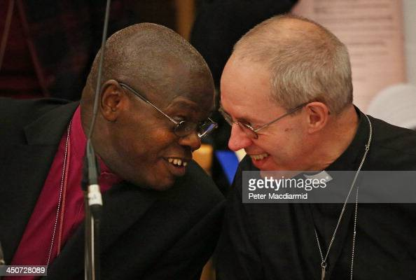 The Archbishop of York John Sentamu talks to The Archbishop of Canterbury Justin Welby during the General Synod at Church House on November 20 2013...