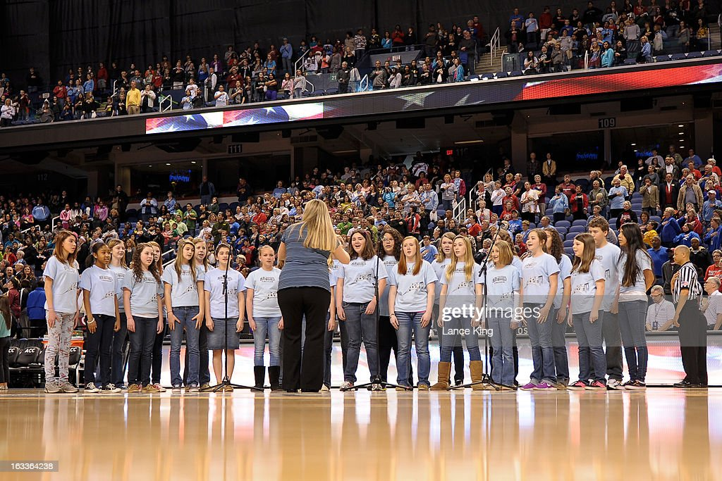 The Archdale - Trinity Middle School (Trinity, NC) chorus performs the National Anthem prior to a game between the Miami Hurricanes and the Florida State Seminoles during the quarterfinals of the 2013 Women's ACC Tournament at the Greensboro Coliseum on March 8, 2013 in Greensboro, North Carolina.