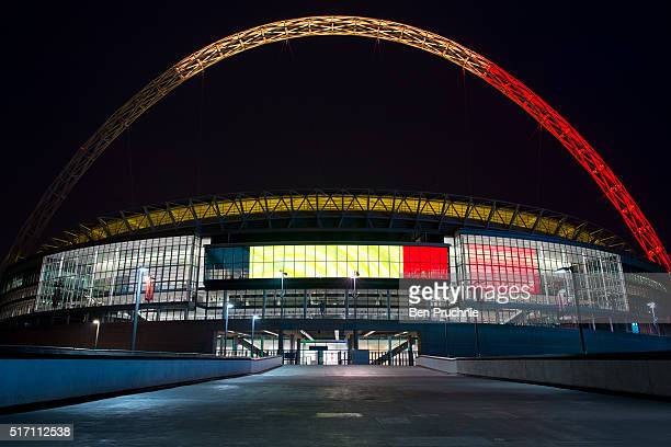 The arches of Wembley Stadium are illuminated with the colours of the flag of Belgium on March 23 2016 in London England Belgium is observing three...