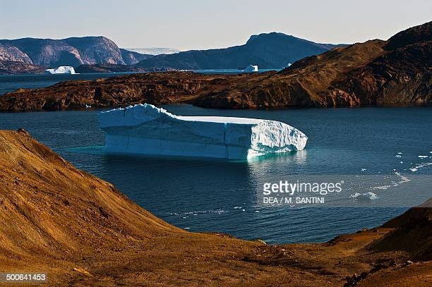The arctic desert with icebergs in the background Uummannaq Qaasuitsup west Greenland Denmark