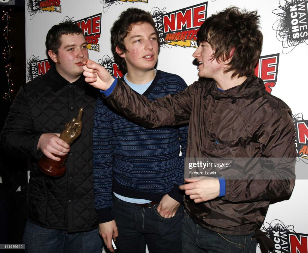 The <a gi-track='captionPersonalityLinkClicked' href=/galleries/search?phrase=Arctic+Monkeys&family=editorial&specificpeople=274715 ng-click='$event.stopPropagation()'>Arctic Monkeys</a>, winners of Best New Band, Best British Band and Best Track for 'I Bet You Look Good On The Dancefloor' at The NME Shockwaves Awards 2006