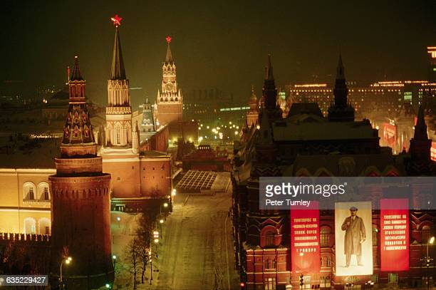 The area around Moscow's Kremlin is lit up at night Banners featuring Lenin's face celebrate the 70th anniversary of his revolution are hung on the...