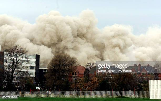 The area smothered in a plume of dust and smoke where St John's House the former Inland Revenue 19storey tower block in Bootle Merseyside had once...