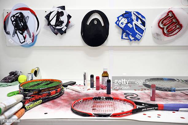 The area where a technician repaints logos onto the strings of restrung racquets is pictured in the restringing workshop on day 8 of the Wimbledon...