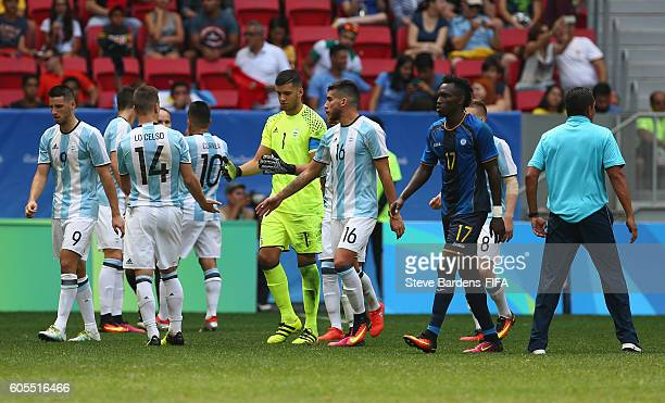 The Argentina players celebrate after Honduras miss a penalty during the Men's First Round Group D match between Argentina and Honduras on Day 5 of...