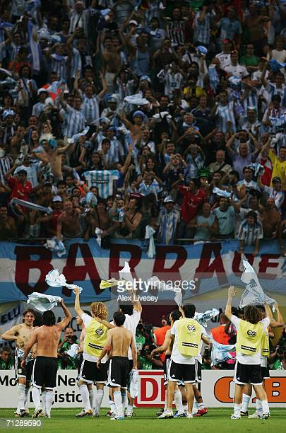 The Argentina players celebrate victory in front of their fans at the end of the FIFA World Cup Germany 2006 Round of 16 match between Argentina and...
