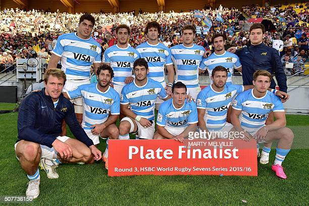 The Argentina team poses for a photo after they lost the plate final against Australia on the second day of the Wellington Sevens rugby Union...