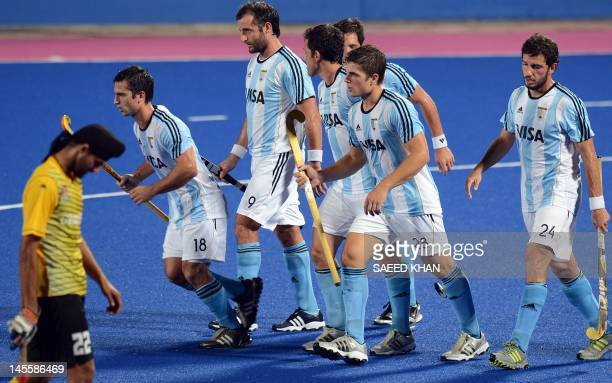 The Argentina team walks across the field after their first and decisive goal against Malaysia during their match at the Sultan Azlan Shah Cup men's...