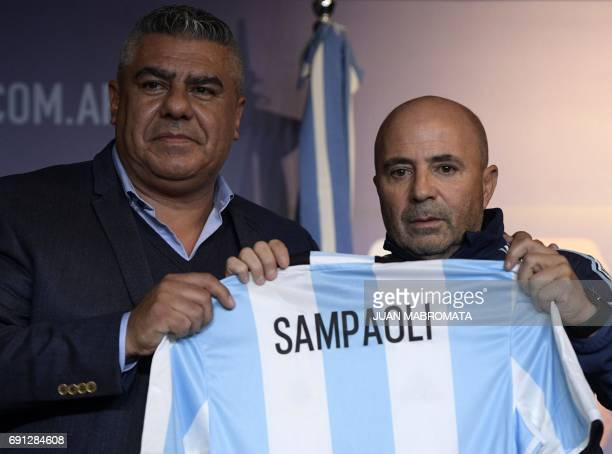 The Argentine football association president Claudio Tapia presents the Argentine football team's new coach Jorge Sampaoli during a press conference...