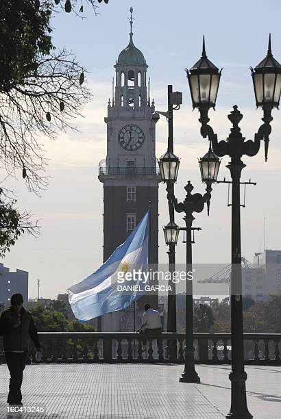 The Argentine national flag flutters May 27 2009 over the Islas Malvinas Memorial a monument that commemorates Argentina's casualties occurred during...