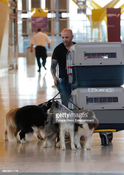 The Argentinian football team coach Jorge Sampaoli and his dogs are seen at Barajas airport on May 24 2017 in Madrid Spain