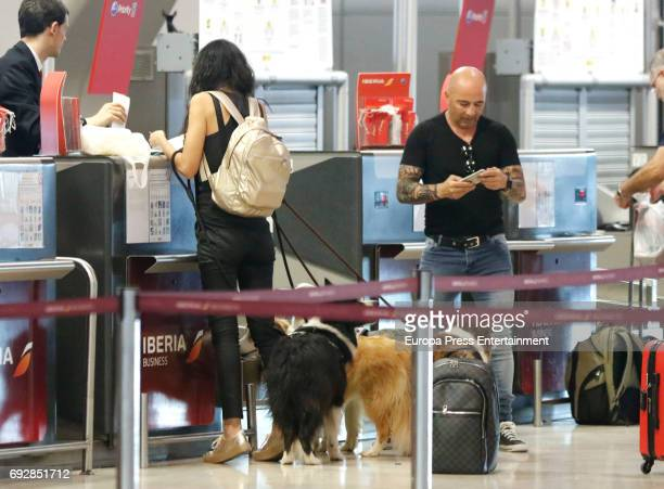 The Argentinian football team coach Jorge Sampaoli Paula Valenzuela and their dogs are seen at Barajas airport on May 24 2017 in Madrid Spain