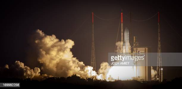 The Ariane 5 blasts off from the ground at the French Guyana European Spaceport of Kourou on June 5 2013 A European rocket blasted off from French...