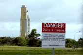 The Ariane 5 launcher is rolled out under high security from the final assembly building at the European Spaceport on May 3 2011 in Kourou French...