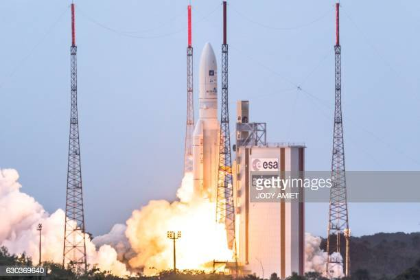 The Ariane V rocket lifts off from the European spaceport in Kourou French Guiana on December 21 2016 carrying onboard two satellites the Star One...