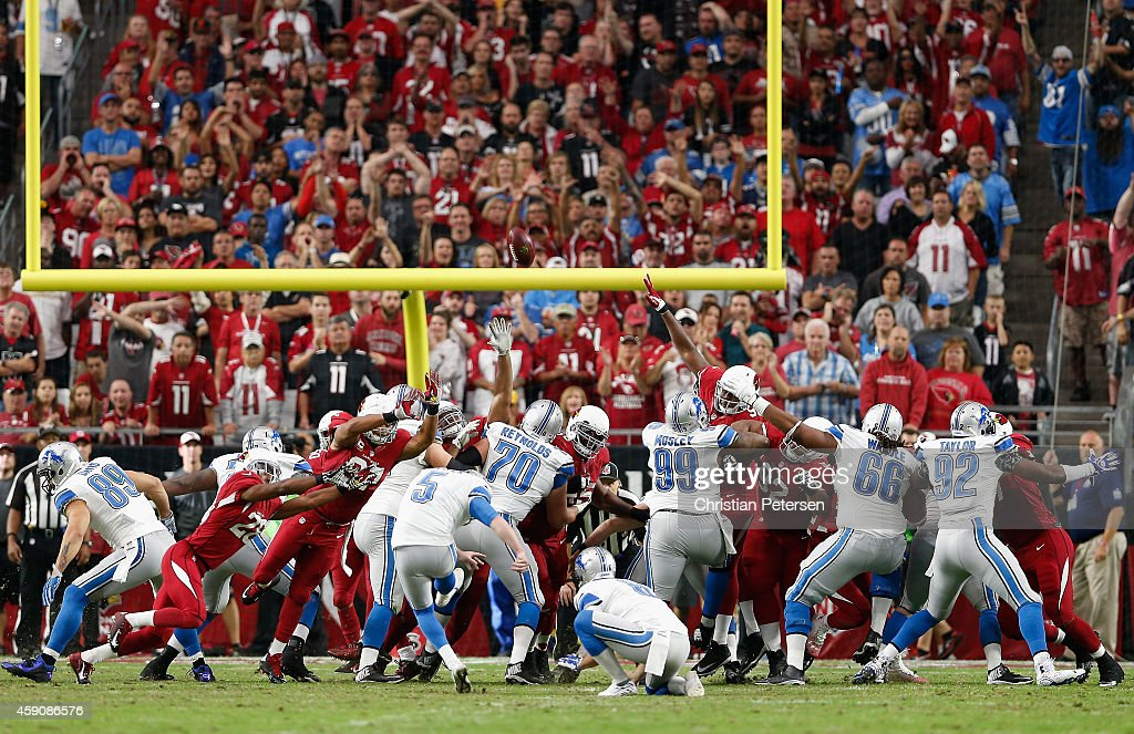 The Arizona Cardinals attempt to block a field goal kicked by kicker <a gi-track='captionPersonalityLinkClicked' href=/galleries/search?phrase=Matt+Prater&family=editorial&specificpeople=4408897 ng-click='$event.stopPropagation()'>Matt Prater</a> #5 of the Detroit Lions during the first half of the NFL game at the University of Phoenix Stadium on November 16, 2014 in Glendale, Arizona.