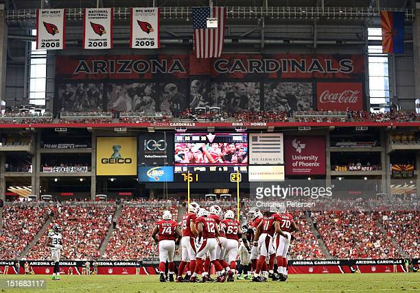 The Arizona Cardinals break from a huddle around quarterback quarterback John Skelton during the season opener against the Seattle Seahawks at the...