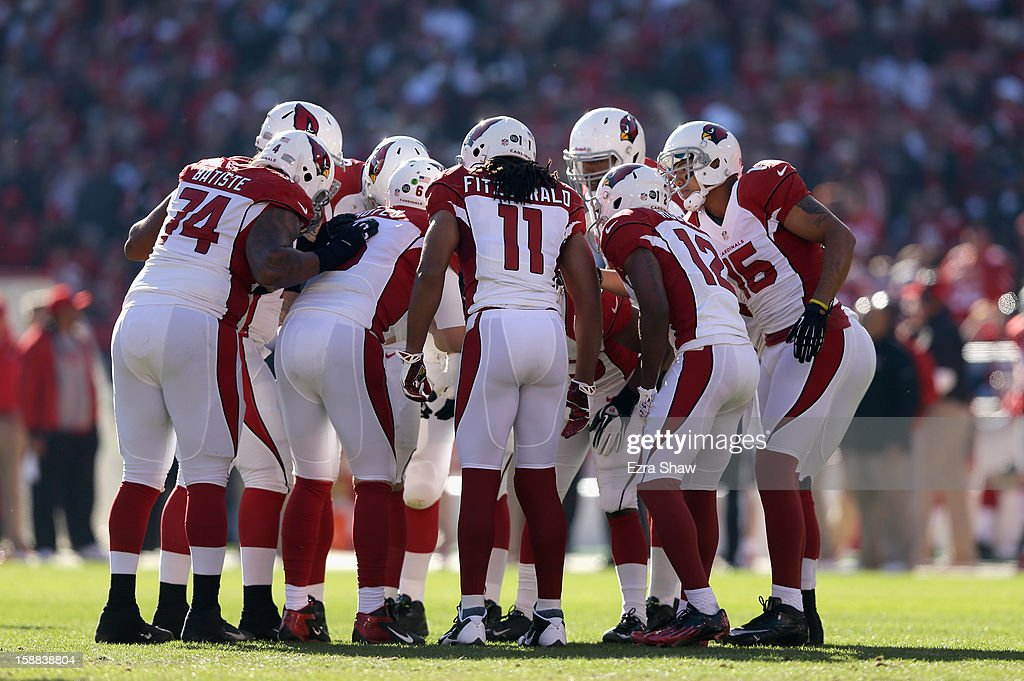 The Arizona Cardinals huddle together during their game against the San Francisco 49ers at Candlestick Park on December 30, 2012 in San Francisco, California.