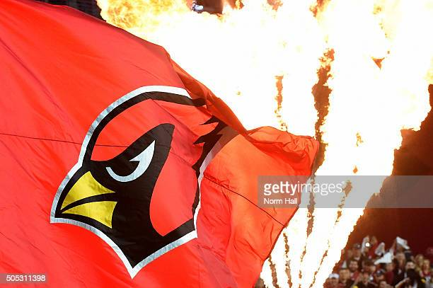 The Arizona Cardinals logo is seen on a flag before the Cardinals take on the Green Bay Packers in the NFC Divisional Playoff Game at University of...