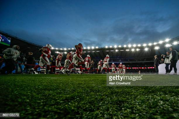 The Arizona Cardinals make their way onto the pitch at the start of the match during the NFL match between the Arizona Cardinals and the Los Angeles...