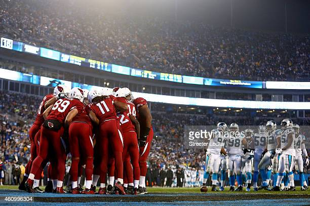 The Arizona Cardinals offense huddles up on their own goal line in the 2nd quarter against the Carolina Panthers during their NFC Wild Card Playoff...