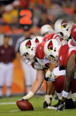 The Arizona Cardinals offense prepares to snap the ball as the Cards offense squares off against the Denver Broncos on the line of scrimmage during...