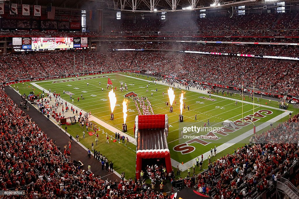 The Arizona Cardinals run onto the field for the NFL game against the New England Patriots at the University of Phoenix Stadium on September 11, 2016 in Glendale, Arizona.