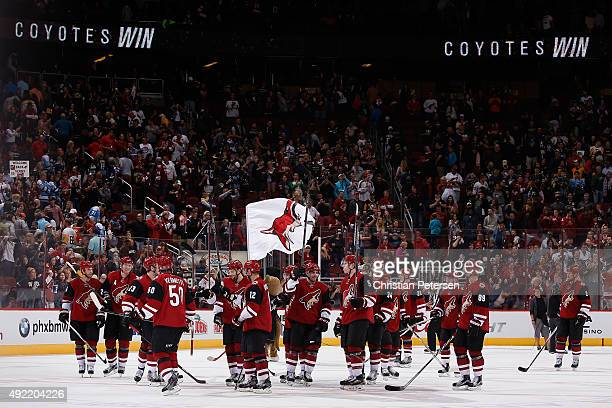 The Arizona Coyotes acknowledge the fans after defeating the Pittsburgh Penguins 21 in the NHL game at Gila River Arena on October 10 2015 in...
