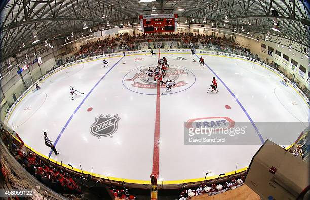 The Arizona Coyotes face the Calgary Flames during Day 4 of NHL Kraft Hockeyville at the Sylvan Lake Multiplex on September 24 2014 in Sylvan Lake...