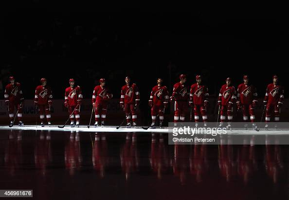 The Arizona Coyotes line up for player introductions to the NHL game against the Winnipeg Jets at Gila River Arena on October 9 2014 in Glendale...