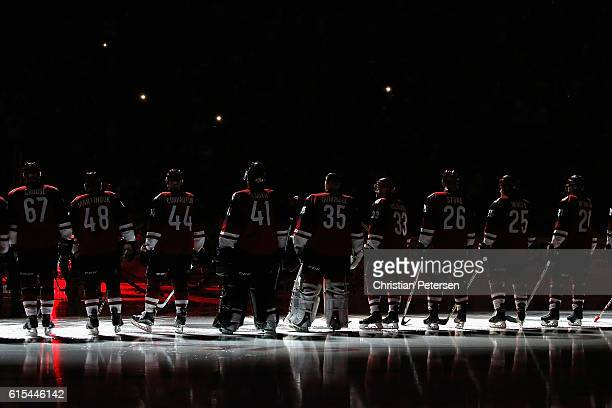 The Arizona Coyotes stand on the ice during introductions to the NHL game against Philadelphia Flyers at Gila River Arena on October 15 2016 in...