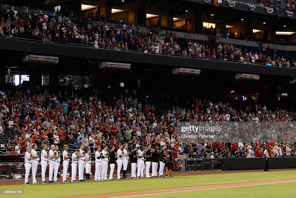 The Arizona Diamondbacks and fans stand attended for the national anthem before the MLB game against the Houston Astros at Chase Field on May 30, 2016 in Phoenix, Arizona.