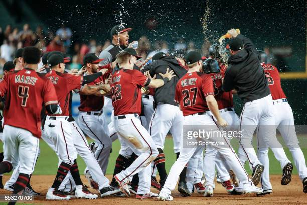 The Arizona Diamondbacks celebrate after a walk off win after the MLB baseball game between the Miami Marlins and the Arizona Diamondbacks on...