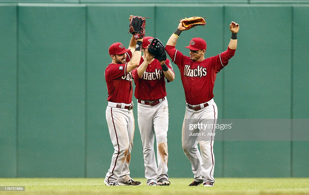 The Arizona Diamondbacks celebrate after defeating the Pittsburgh Pirates in sixteenth inning 4-2 on August 18, 2013 at PNC Park in Pittsburgh, Pennsylvania.