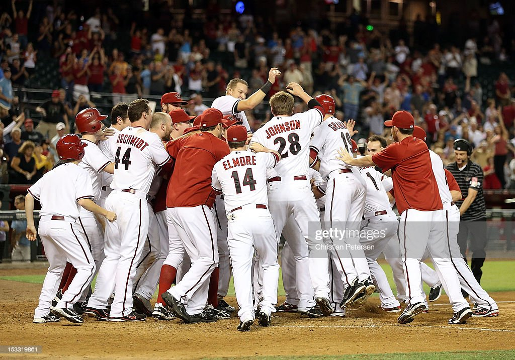 The Arizona Diamondbacks celebrate around Aaron Hill #2 after he hit a walk off three-run home run against the Colorado Rockies during the ninth inning of the MLB game at Chase Field on October 2, 2012 in Phoenix, Arizona. The Diamondbacks defeated the Rockies 5-3.