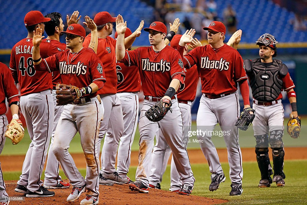 The Arizona Diamondbacks celebrate victory over the Tampa Bay Rays at Tropicana Field on July 31, 2013 in St. Petersburg, Florida.