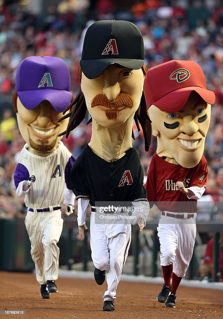 The Arizona Diamondbacks 'legends' mascots (L-R) Luis Gonzalez, Randy Johnson and Matt Williams compete in a race during a break from the MLB game between the Arizona Diamondbacks and the Colorado Rockies at Chase Field on April 27, 2013 in Phoenix, Arizona.