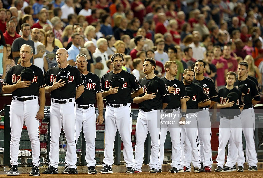 The Arizona Diamondbacks stand attended for the National Anthem before the MLB game against the Milwaukee Brewers at Chase Field on July 13, 2013 in Phoenix, Arizona.