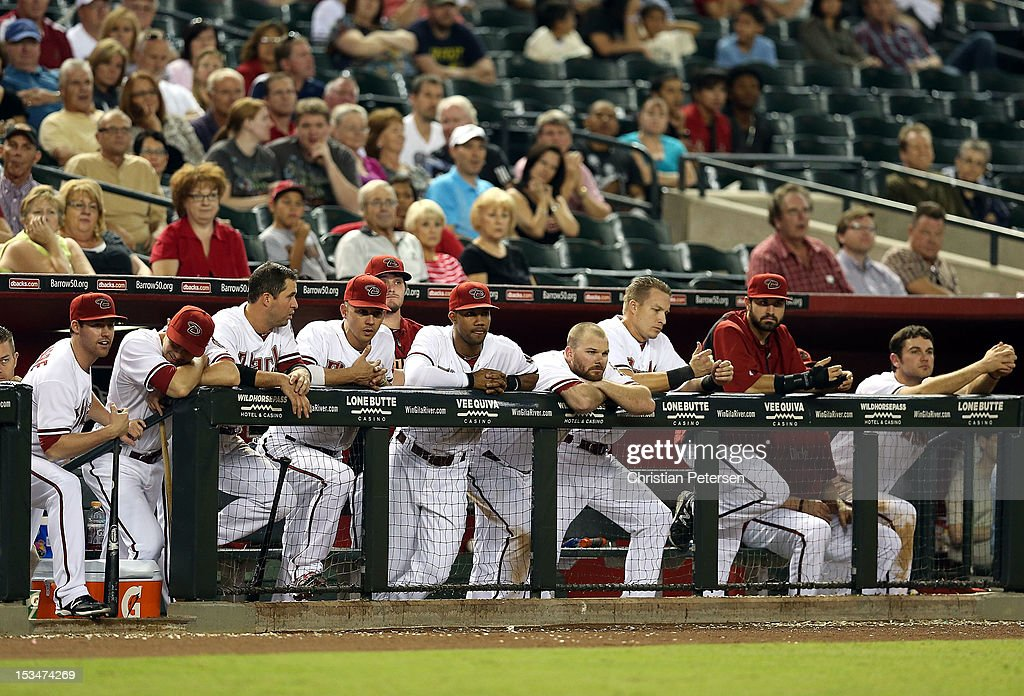 The Arizona Diamondbacks watch from the bench during the MLB game against the Colorado Rockies at Chase Field on October 2, 2012 in Phoenix, Arizona.