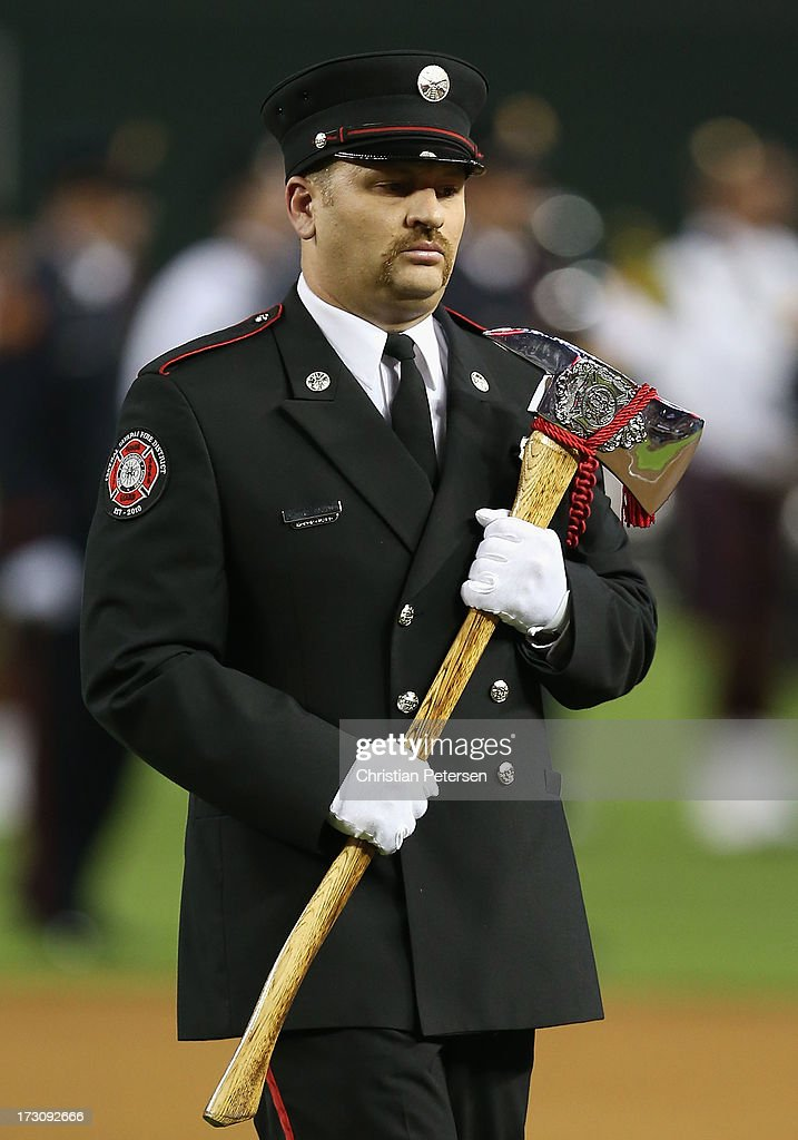 The Arizona Joint Fire Fighters Honor Guard honor of the 19 Granite Mountain Interagency Hotshot Crew firefighters who died battling a fast-moving wildfire near Yarnell, AZ before the MLB game between the Arizona Diamondbacks and the Colorado Rockies at Chase Field on July 5, 2013 in Phoenix, Arizona.