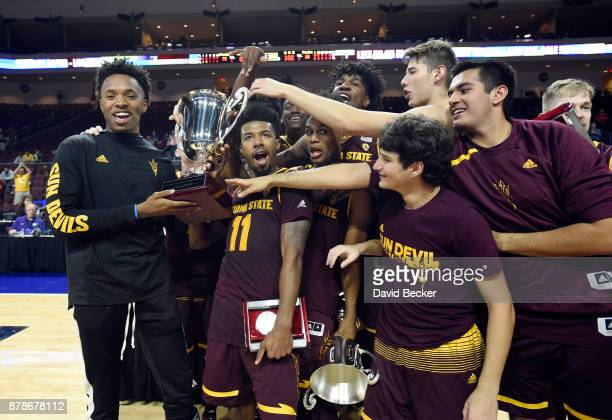 The Arizona State Sun Devils celebrate with their trophy after defeating the Xavier Musketeers in the championship game of the 2017 Continental Tire...