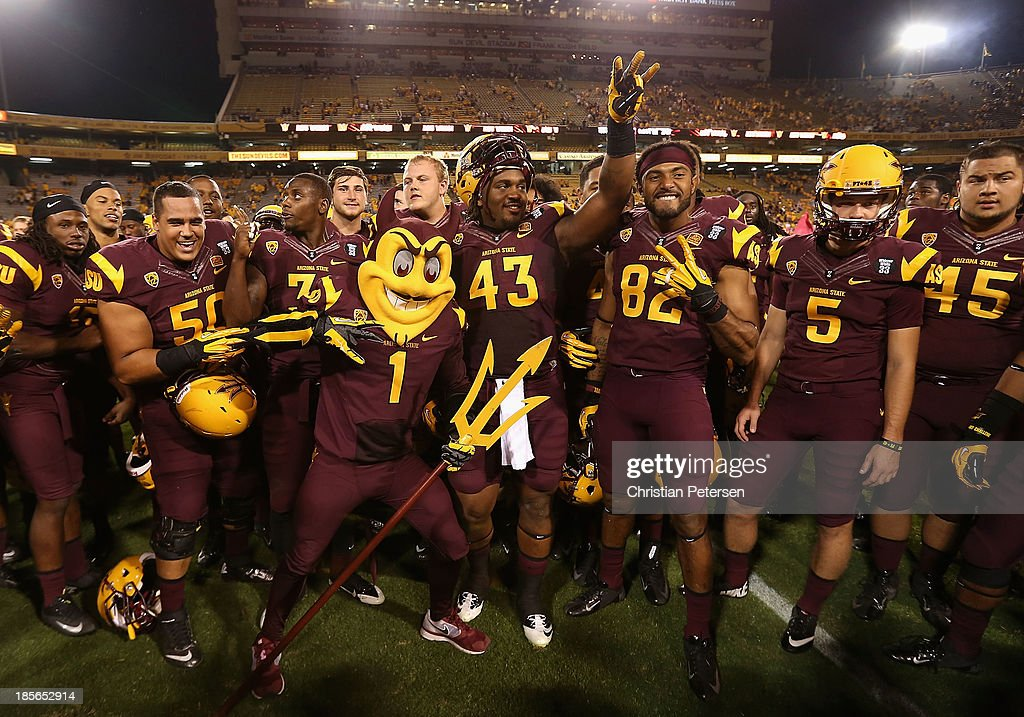 The Arizona State Sun Devils pose together after defeating the Washington Huskies in the college football game at Sun Devil Stadium on October 19, 2013 in Tempe, Arizona. The Sun Devils defeated the Huskies 53-24.